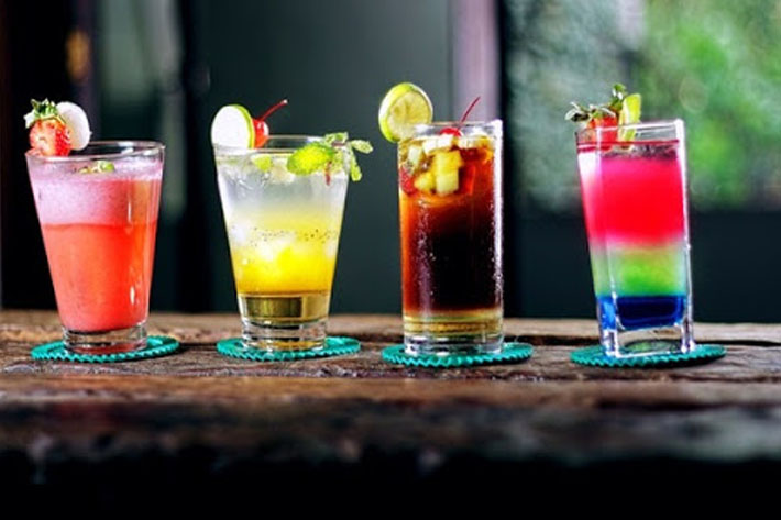 Glasses of different cocktail mixes