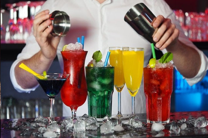 Bartender with a variety of cocktails