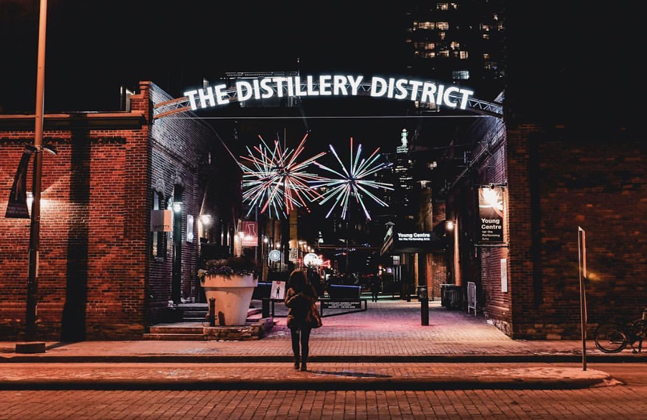 The entrance to the Distillery District at night