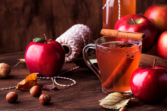 Mulled pear and cranberry punch with cinnamon sticks and cloves