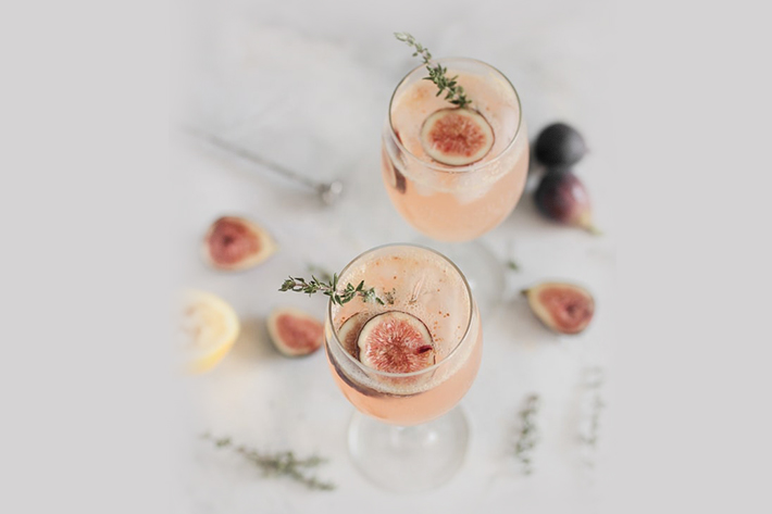 Two cocktails in wine glasses