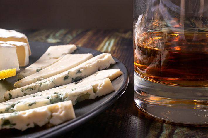 Whisky poured neat with blue cheese accompaniments