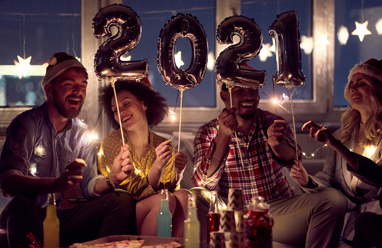 Four people celebrate New Year's Eve at home