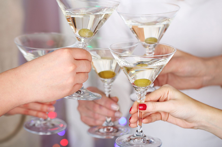 Women toasting martinis to Women's History Month